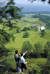 Hikers and scenic view of Ft. Lewis Lodge in Bath County, Virginia
